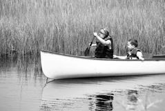 Children paddling through wetlands Royalty Free Stock Photo