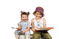 Children paint with bright colors. On an isolated background stock image