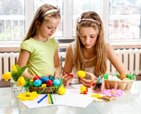 Children paint Easter eggs at home. Stock Image