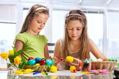 Children paint Easter eggs at home royalty free stock images