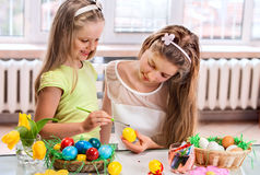 Children paint Easter eggs at home Royalty Free Stock Photo