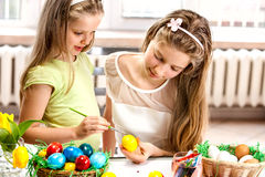 Children paint Easter eggs at home. Stock Photo