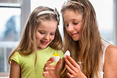 Children paint Easter eggs at home Stock Photo