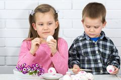 Children paint eggs for the holiday Easter royalty free stock photos