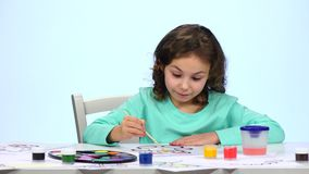 Children paint a picture with pencils and admire their work. Close up. White background. Time lapse stock footage
