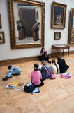 Children paint sitting on floor in the Tretyakov Gallery in Moscow Stock Photo