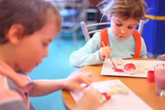 Children paint toys from clay Royalty Free Stock Photo