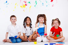 Children with paintbrushes. Lovely children with paintbrushes and paint roller Stock Photos