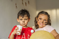 Children with painted face having fun in kids party Royalty Free Stock Images