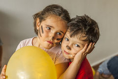 Children with painted face having fun in kids party Stock Photos