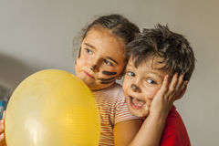 Children with painted face having fun in kids party Stock Image