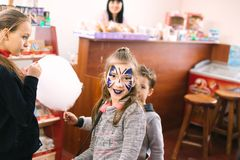Children with painted faces at the opening of a children`s center March 23, 2018 in Cherkassy, Ukraine stock photography