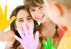 Children painted hands playing Stock Images
