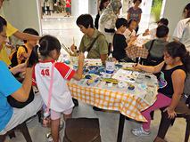 Children painting with adults Royalty Free Stock Images