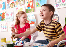 Children painting in art class. Stock Photos