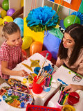 Children painting and drawing. Art lesson in primary school. Children painting and drawing in kids club. Art lesson in primary school. Kindergarten teacher help Royalty Free Stock Photo