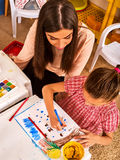 Children painting and drawing. Craft lesson in primary school. Royalty Free Stock Photography
