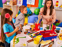 Children painting and drawing together . Craft lesson in primary school. Stock Photo