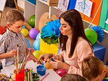 Children painting and drawing together . Craft lesson in primary school. Children painting and drawing in kids club. Craft lesson in primary school Royalty Free Stock Photography
