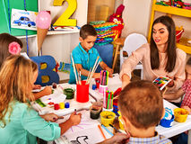 Children painting and drawing together . Craft lesson in primary school. Stock Photography