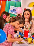 Children painting and drawing together . Craft lesson in primary school. Children painting and drawing in kids club. Craft lesson in primary school Stock Photo