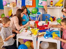 Children painting and drawing together. Craft lesson in primary school. Kids playroom organization of children painting and drawing kid`s club. Craft lesson in Stock Photography