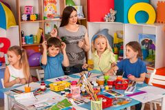 Children painting and drawing together. Craft lesson in primary school. Kids playroom organization of children painting and drawing in kid`s club. Craft lesson Royalty Free Stock Photography