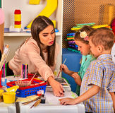 Children painting and drawing together . Craft lesson in primary school. Kids playroom organization of children painting and drawing in kid`s club. Craft lesson Stock Image