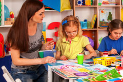 Children painting and drawing together. Craft lesson in primary school. Kids playroom organization of children painting and drawing in kid`s club. Craft lesson Royalty Free Stock Photo