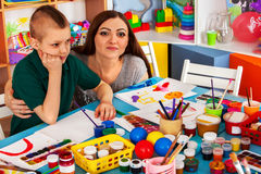 Children painting and drawing together . Craft lesson in primary school. Kids playroom organization of children painting and drawing in kid`s club. Craft lesson Stock Photos