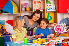 Children painting and drawing together . Craft lesson in primary school. Kids playroom organization of children painting and drawing in kid`s club. Craft lesson Royalty Free Stock Photography