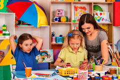 Children painting and drawing together. Craft lesson in primary school. Kids playroom organization of children painting and drawing in kid`s club. Craft lesson Royalty Free Stock Image