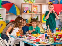 Children painting and drawing together. Craft lesson in primary school. Kids playroom organization of children painting and drawing in kid`s club. Craft lesson Stock Photos