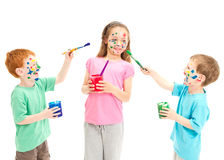 Children painting on each other. Children painting faces on each other with paint. Isolated on white Royalty Free Stock Images