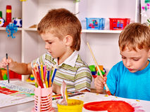 Children painting at easel Royalty Free Stock Photos
