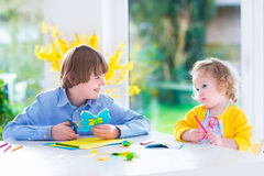 Children painting Easter crafts Stock Image