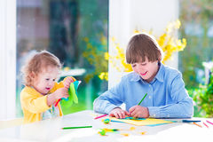 Children painting Easter crafts Stock Photo