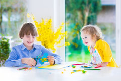 Children painting Easter crafts Royalty Free Stock Photography