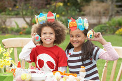 Children Painting Easter Eggs In Gardens Stock Photos