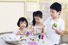 Children painting easter eggs Royalty Free Stock Photography