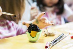 Children painting eggs Stock Image
