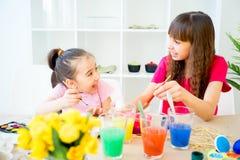 Children painting eggs stock photo