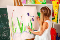 Children painting finger on easel. Group of kids with teacher. Children painting finger on easel. Group of kids girl and boy with teacher learn paint in class Stock Photography