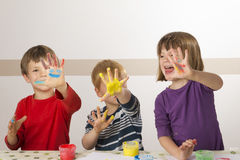 Children painting with finger paint Royalty Free Stock Photo