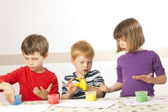Children painting with finger paint Royalty Free Stock Photos