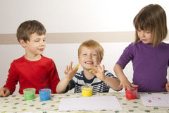 Children painting with finger paint Stock Photos