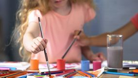 Children painting with gouache at art lesson in primary school, childhood. Stock photo stock image