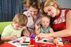 Children painting with his mothers Stock Photos
