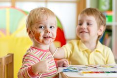 Children painting at home or playschool Stock Photos