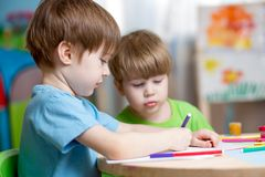 Children painting in nursery at home. Children boys painting in nursery at home stock photography